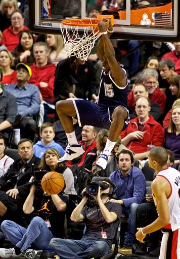 Feb 11, 2014; Portland, OR, USA; Oklahoma City Thunder point guard Reggie Jackson (15) dunks over Portland Trail Blazers small forward Nicolas Batum (88) during the third quarter at the Moda Center. Mandatory Credit: Craig Mitchelldyer-USA TODAY Sports