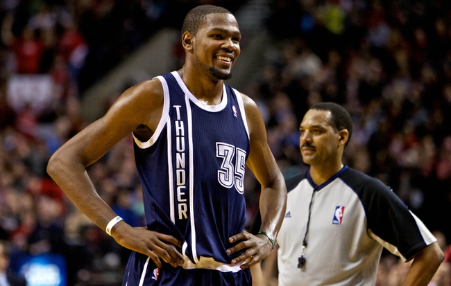 Feb 11, 2014; Portland, OR, USA; Oklahoma City Thunder small forward Kevin Durant (35) smiles after being called for a technical foul during the fourth quarter against the Portland Trail Blazers at the Moda Center. Mandatory Credit: Craig Mitchelldyer-USA TODAY Sports