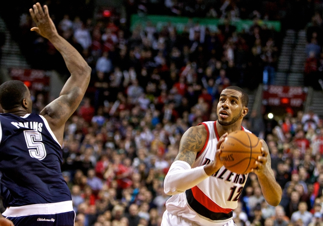 Feb 11, 2014; Portland, OR, USA; Portland Trail Blazers power forward LaMarcus Aldridge (12) takes a shot over Oklahoma City Thunder with 5 seconds remaining in the game at the Moda Center. Mandatory Credit: Craig Mitchelldyer-USA TODAY Sports