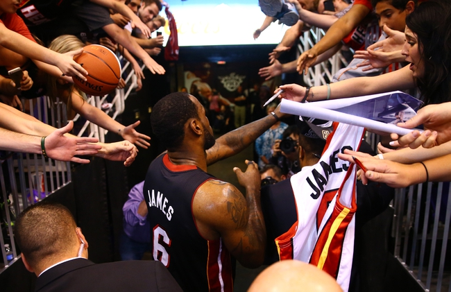 Feb 11, 2014; Phoenix, AZ, USA; Miami Heat forward LeBron James greets fans following the game against the Phoenix Suns at the US Airways Center. The Heat defeated the Suns 103-97. Mandatory Credit: Mark J. Rebilas-USA TODAY Sports