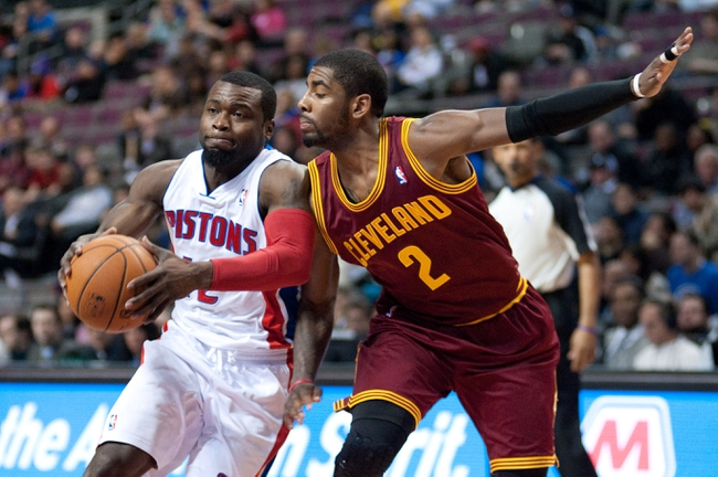 Feb 12, 2014; Auburn Hills, MI, USA; Detroit Pistons point guard Will Bynum (12) drives to the basket against Cleveland Cavaliers point guard Kyrie Irving (2) during the second quarter at The Palace of Auburn Hills. Mandatory Credit: Tim Fuller-USA TODAY Sports