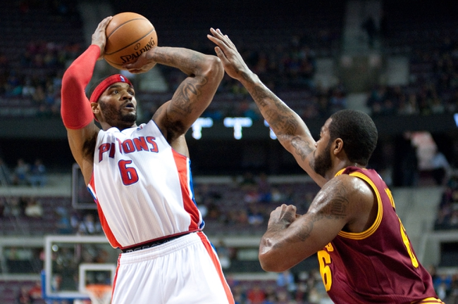 Feb 12, 2014; Auburn Hills, MI, USA; Detroit Pistons small forward Josh Smith (6) shoots over Cleveland Cavaliers small forward Earl Clark (6) during the second quarter at The Palace of Auburn Hills. Mandatory Credit: Tim Fuller-USA TODAY Sports