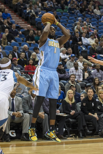 Feb 12, 2014; Minneapolis, MN, USA; Denver Nuggets small forward Jordan Hamilton (1) goes up for a shot in the first half against the Minnesota Timberwolves at Target Center. Mandatory Credit: Jesse Johnson-USA TODAY Sports