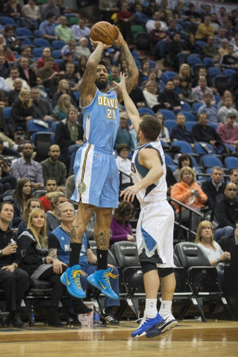 Feb 12, 2014; Minneapolis, MN, USA; Denver Nuggets small forward Wilson Chandler (21) goes up for a shot over Minnesota Timberwolves point guard J.J. Barea (11) in the first half at Target Center. Mandatory Credit: Jesse Johnson-USA TODAY Sports