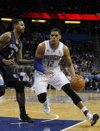 Feb 12, 2014; Orlando, FL, USA; Orlando Magic small forward Tobias Harris (12) moves to the basket as Memphis Grizzlies power forward James Johnson (3) defends during the second half at Amway Center. Memphis Grizzlies defeated the Orlando Magic 86-81. Mandatory Credit: Kim Klement-USA TODAY Sports