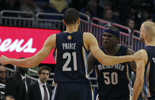 Feb 12, 2014; Orlando, FL, USA; Memphis Grizzlies power forward Zach Randolph (50) reacts with small forward Tayshaun Prince (21) during the second half at Amway Center. Memphis Grizzlies defeated the Orlando Magic 86-81. Mandatory Credit: Kim Klement-USA TODAY Sports
