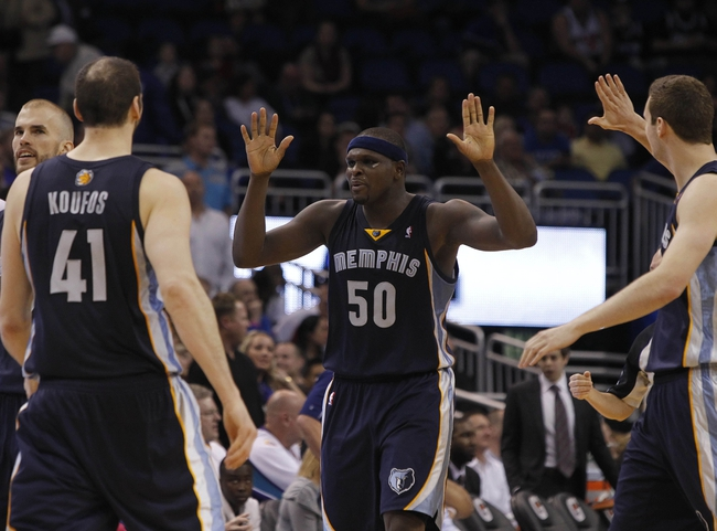 Feb 12, 2014; Orlando, FL, USA; Memphis Grizzlies power forward Zach Randolph (50) is congratulated by teammates after the made a shot during the second half at Amway Center. Memphis Grizzlies defeated the Orlando Magic 86-81. Mandatory Credit: Kim Klement-USA TODAY Sports