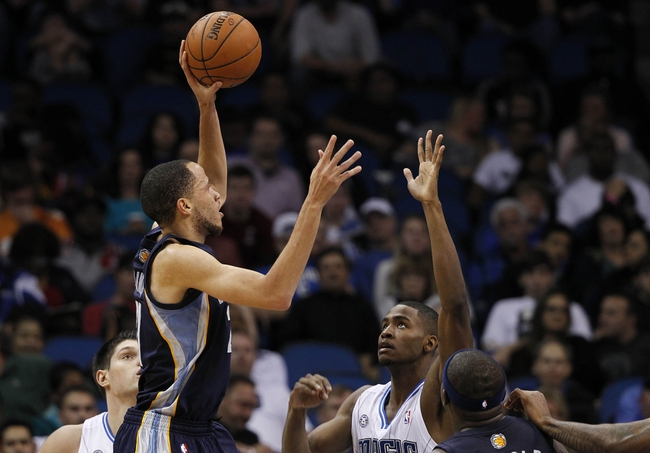 Feb 12, 2014; Orlando, FL, USA; Memphis Grizzlies small forward Tayshaun Prince (21) shoots over Orlando Magic small forward Maurice Harkless (21) during the second half at Amway Center. Memphis Grizzlies defeated the Orlando Magic 86-81. Mandatory Credit: Kim Klement-USA TODAY Sports
