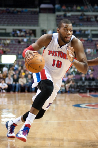 Feb 12, 2014; Auburn Hills, MI, USA; Detroit Pistons power forward Greg Monroe (10) during the first quarter against the Cleveland Cavaliers at The Palace of Auburn Hills. Mandatory Credit: Tim Fuller-USA TODAY Sports