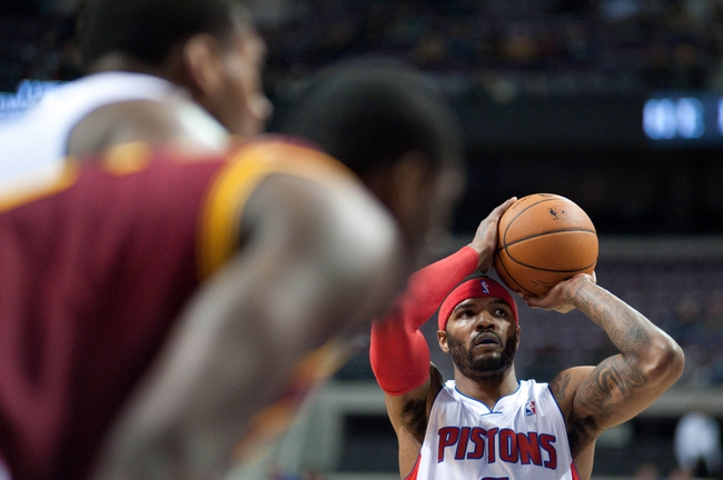 Feb 12, 2014; Auburn Hills, MI, USA; Detroit Pistons small forward Josh Smith (6) shoots a free throw during the first quarter against the Cleveland Cavaliers at The Palace of Auburn Hills. Mandatory Credit: Tim Fuller-USA TODAY Sports
