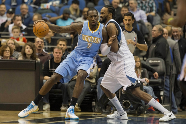 Feb 12, 2014; Minneapolis, MN, USA; Denver Nuggets center J.J. Hickson (7) attempts to drive to the basket around Minnesota Timberwolves center Ronny Turiaf (32) in the second half at Target Center. The Timberwolves won 117-90. Mandatory Credit: Jesse Johnson-USA TODAY Sports