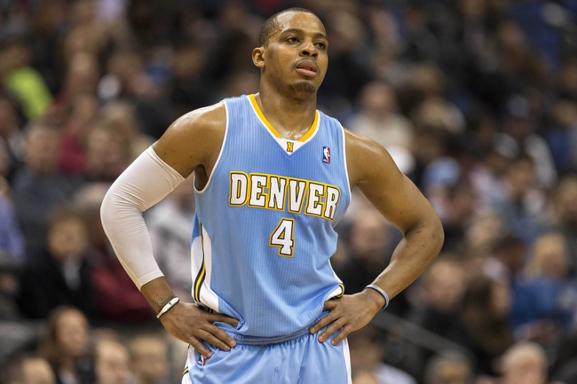 Feb 12, 2014; Minneapolis, MN, USA; Denver Nuggets shooting guard Randy Foye (4) looks on during the second half against the Minnesota Timberwolves at Target Center. The Timberwolves won 117-90. Mandatory Credit: Jesse Johnson-USA TODAY Sports