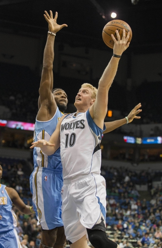 Feb 12, 2014; Minneapolis, MN, USA; Minnesota Timberwolves small forward Chase Budinger (10) goes up for a layup past Denver Nuggets power forward Kenneth Faried (35) in the second half at Target Center. The Timberwolves won 117-90. Mandatory Credit: Jesse Johnson-USA TODAY Sports
