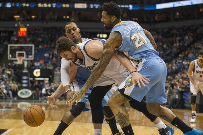 Feb 12, 2014; Minneapolis, MN, USA; Minnesota Timberwolves power forward Kevin Love (42) attempts to get a loose ball as Denver Nuggets shooting guard Randy Foye (4) and small forward Wilson Chandler (21) play defense in the second half at Target Center. The Timberwolves won 117-90. Mandatory Credit: Jesse Johnson-USA TODAY Sports