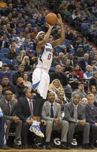Feb 12, 2014; Minneapolis, MN, USA; Minnesota Timberwolves small forward Corey Brewer (13) goes up for a shot in the second half against the Denver Nuggets at Target Center. The Timberwolves won 117-90. Mandatory Credit: Jesse Johnson-USA TODAY Sports