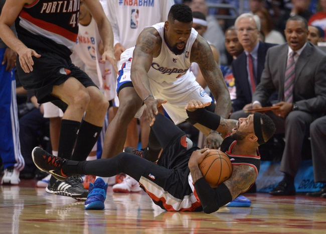 Feb 12, 2014; Los Angeles, CA, USA; Portland Trail Blazers guard Mo Williams (25) battles for the ball with Los Angeles Clippers center DeAndre Jordan (6) at Staples Center. The Clippers defeated the Trail Blazers 122-117. Mandatory Credit: Kirby Lee-USA TODAY Sports