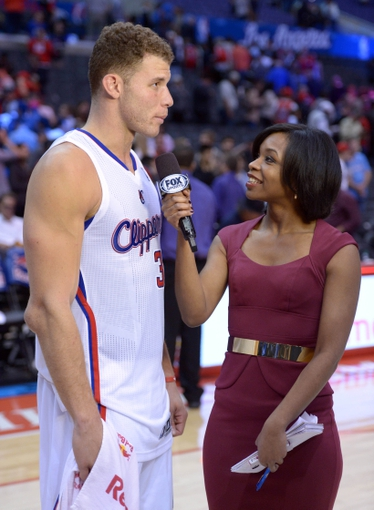 Feb 12, 2014; Los Angeles, CA, USA; Fox Sports reporter Kristina Pink (right) interviews Los Angeles Clippers forward Blake Griffin (32) after the game against the Portland Trail Blazers at Staples Center. The Clippers defeated the Trail Blazers 122-117. Mandatory Credit: Kirby Lee-USA TODAY Sports
