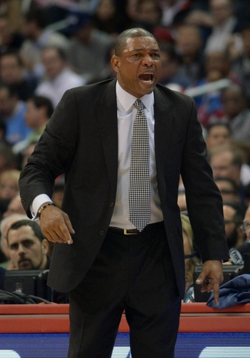 Feb 12, 2014; Los Angeles, CA, USA; Los Angeles Clippers coach Doc Rivers reacts during the game against the Portland Trail Blazers at Staples Center. The Clippers defeated the Trail Blazers 122-117. Mandatory Credit: Kirby Lee-USA TODAY Sports