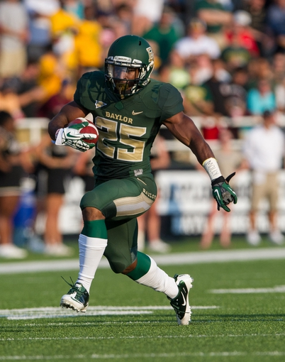 Aug 31, 2013; Waco, TX, USA; Baylor Bears running back Lache Seastrunk (25) during the game against the Wofford Terriers at Floyd Casey Stadium. The Bears defeated the Terriers 69-3. Mandatory Credit: Jer