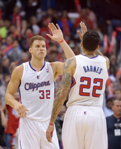 Feb 12, 2014; Los Angeles, CA, USA; Los Angeles Clippers forwards Blake Griffin (32) and Matt Barnes (22) high five in the fourth quarter against the Portland Trail Blazers at Staples Center. The Clippers defeated the Trail Blazers 122-117. Mandatory Credit: Kirby Lee-USA TODAY Sports