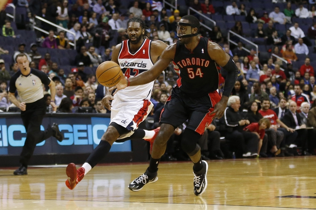 Feb 18, 2014; Washington, DC, USA; Toronto Raptors power forward Patrick Patterson (54) battles for the ball with Washington Wizards power forward Nene (42) in the first quarter at Verizon Center. Mandatory Credit: Geoff Burke-USA TODAY Sports