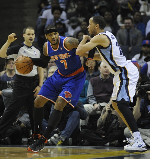 Feb 18, 2014; Memphis, TN, USA; New York Knicks small forward Carmelo Anthony (7) posts up against Memphis Grizzlies small forward Tayshaun Prince (21) during the first quarter at FedExForum. Mandatory Credit: Justin Ford-USA TODAY Sports