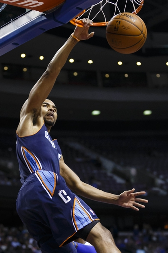 Feb 18, 2014; Auburn Hills, MI, USA; Charlotte Bobcats point guard Ramon Sessions (7) dunks in the first half against the Detroit Pistons at The Palace of Auburn Hills. Mandatory Credit: Rick Osentoski-USA TODAY Sports