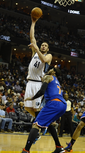 Feb 18, 2014; Memphis, TN, USA; Memphis Grizzlies center Kosta Koufos (41) shoots over New York Knicks small forward Carmelo Anthony (7) during the second quarter at FedExForum. Mandatory Credit: Justin Ford-USA TODAY Sports