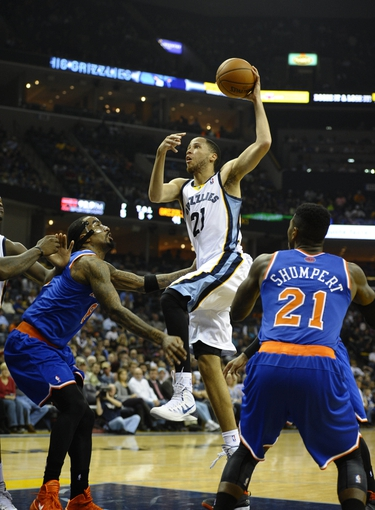 Feb 18, 2014; Memphis, TN, USA; Memphis Grizzlies small forward Tayshaun Prince (21) shoots over New York Knicks shooting guard J.R. Smith (8) at FedExForum. Mandatory Credit: Justin Ford-USA TODAY Sports