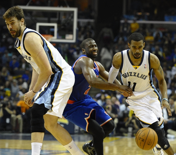 Feb 18, 2014; Memphis, TN, USA; Memphis Grizzlies point guard Mike Conley (11) handles the ball against New York Knicks point guard Raymond Felton (2) during the second quarter at FedExForum. Mandatory Credit: Justin Ford-USA TODAY Sports
