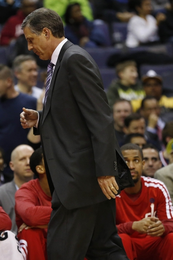 Feb 18, 2014; Washington, DC, USA; Washington Wizards head coach Randy Wittman walks off the court after being ejected against the Toronto Raptors in the fourth quarter at Verizon Center. The Raptors won 103-93. Mandatory Credit: Geoff Burke-USA TODAY Sports