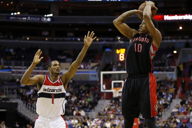 Feb 18, 2014; Washington, DC, USA; Toronto Raptors shooting guard DeMar DeRozan (10) shoots the ball over Washington Wizards small forward Trevor Ariza (1) in the fourth quarter at Verizon Center. The Raptors won 103-93. Mandatory Credit: Geoff Burke-USA TODAY Sports