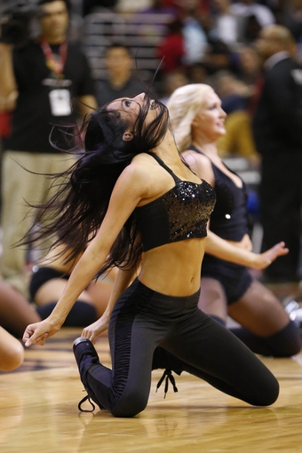Feb 18, 2014; Washington, DC, USA; A Washington Wizards girl dances on the court during a stoppage in play against the Toronto Raptors at Verizon Center. The Raptors won 103-93. Mandatory Credit: Geoff Burke-USA TODAY Sports