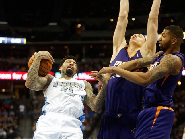 Feb 18, 2014; Denver, CO, USA; Denver Nuggets forward Wilson Chandler (21) is fouled as he drives to the basket during the first half against the Phoenix Suns at Pepsi Center. Mandatory Credit: Chris Humphreys-USA TODAY Sports