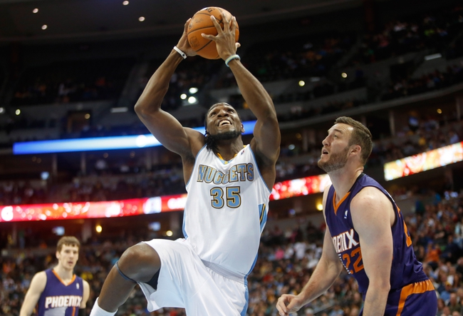 Feb 18, 2014; Denver, CO, USA; Denver Nuggets forward Kenneth Faried (35) shoots the ball next to Phoenix Suns center Miles Plumlee (22) during the first half at Pepsi Center. Mandatory Credit: Chris Humphreys-USA TODAY Sports
