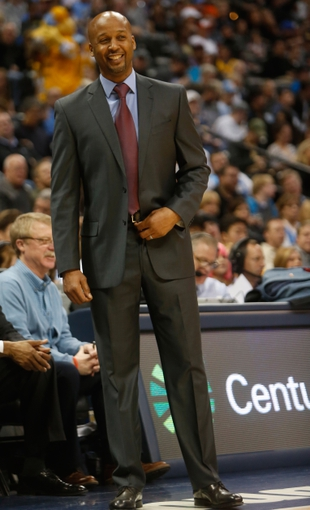 Feb 18, 2014; Denver, CO, USA; Denver Nuggets head coach Brian Shaw during the first half against the Phoenix Suns at Pepsi Center. Mandatory Credit: Chris Humphreys-USA TODAY Sports