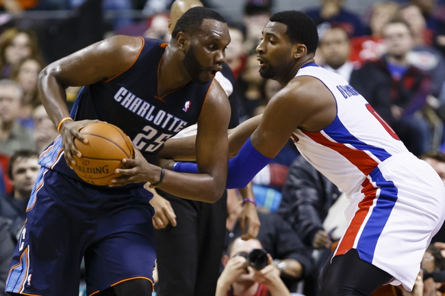 Feb 18, 2014; Auburn Hills, MI, USA; Charlotte Bobcats center Al Jefferson (25) is defended by Detroit Pistons cent at Andre Drummond (0) in the second half at The Palace of Auburn Hills. Mandatory Credit: Rick Osentoski-USA TODAY Sports