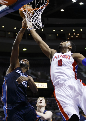 Feb 18, 2014; Auburn Hills, MI, USA; Charlotte Bobcats feater Al Jefferson (25) and Detroit Pistons cent at Andre Drummond (0) goes for the rebound in the third quarter at The Palace of Auburn Hills. Charlotte won 108-96. Mandatory Credit: Rick Osentoski-USA TODAY Sports