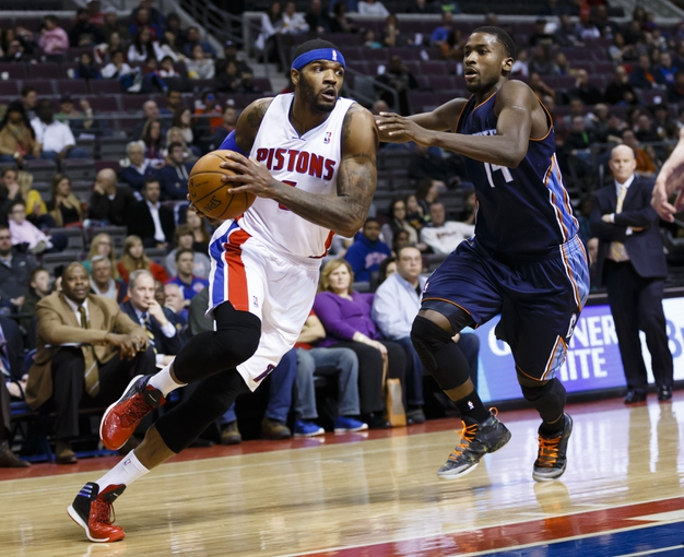 Feb 18, 2014; Auburn Hills, MI, USA; Detroit Pistons small forward Josh Smith (6) moves the ball defended by Charlotte Bobcats small forward Michael Kidd-Gilchrist (14) in the third quarter at The Palace of Auburn Hills. Charlotte won 108-96. Mandatory Credit: Rick Osentoski-USA TODAY Sports