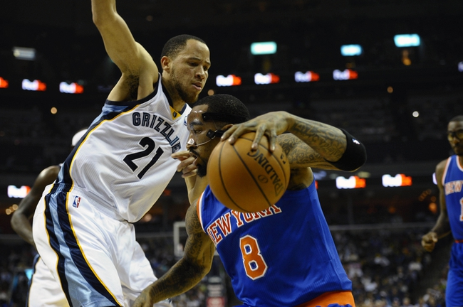 Feb 18, 2014; Memphis, TN, USA; Memphis Grizzlies small forward Tayshaun Prince (21) guards New York Knicks shooting guard J.R. Smith (8) during the game at FedExForum. Memphis Grizzlies beat New York Knicks 98 - 93. Mandatory Credit: Justin Ford-USA TODAY Sports