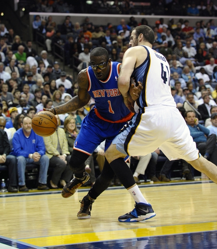 Feb 18, 2014; Memphis, TN, USA; New York Knicks power forward Amar'e Stoudemire (1) drives to the basket against Memphis Grizzlies center Kosta Koufos (41) at FedExForum. Memphis Grizzlies beat New York Knicks 98 - 93. Mandatory Credit: Justin Ford-USA TODAY Sports