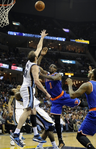 Feb 18, 2014; Memphis, TN, USA; New York Knicks power forward Amar'e Stoudemire (1) shoots over Memphis Grizzlies center Kosta Koufos (41) during the game at FedExForum. Memphis Grizzlies beat New York Knicks 98 - 93. Mandatory Credit: Justin Ford-USA TODAY Sports