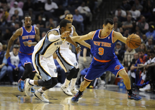 Feb 18, 2014; Memphis, TN, USA; New York Knicks point guard Pablo Prigioni (9) steals the ball from Memphis Grizzlies point guard Mike Conley (11) during the game at FedExForum. Memphis Grizzlies beat New York Knicks 98 - 93. Mandatory Credit: Justin Ford-USA TODAY Sports