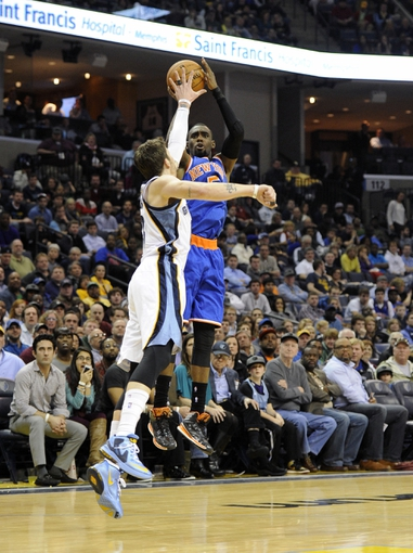 Feb 18, 2014; Memphis, TN, USA; New York Knicks shooting guard Tim Hardaway Jr. (5) shoots over Memphis Grizzlies small forward Mike Miller (13) during the game at FedExForum. Memphis Grizzlies beat New York Knicks 98 - 93. Mandatory Credit: Justin Ford-USA TODAY Sports
