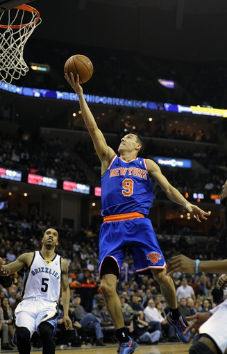 Feb 18, 2014; Memphis, TN, USA; New York Knicks point guard Pablo Prigioni (9) lays the ball up against the Memphis Grizzlies during the game at FedExForum. Memphis Grizzlies beat New York Knicks 98 - 93. Mandatory Credit: Justin Ford-USA TODAY Sports