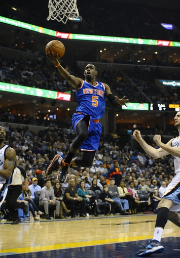 Feb 18, 2014; Memphis, TN, USA; New York Knicks shooting guard Tim Hardaway Jr. (5) lays the ball up against the Memphis Grizzlies during the game at FedExForum. Memphis Grizzlies beat New York Knicks 98 - 93. Mandatory Credit: Justin Ford-USA TODAY Sports