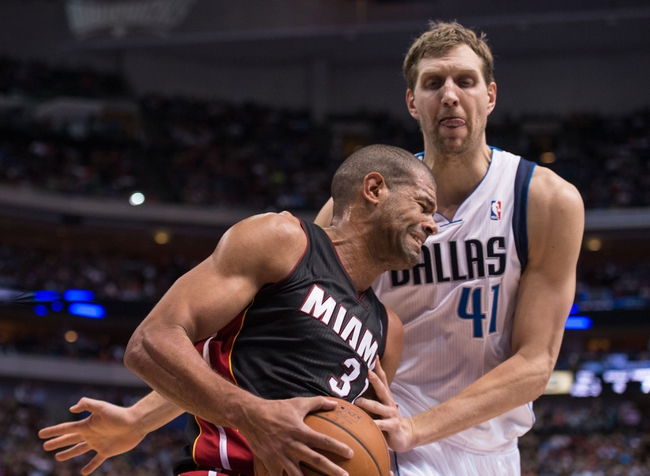 Feb 18, 2014; Dallas, TX, USA; Dallas Mavericks power forward Dirk Nowitzki (41) defends against Miami Heat small forward Shane Battier (31) during the second half at the American Airlines Center. The Heat defeated the Mavericks  117-106. Mandatory Credit: Jerome Miron-USA TODAY Sports