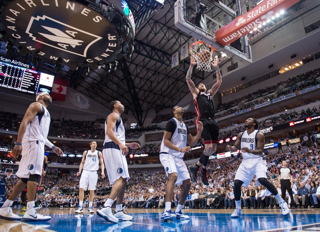 Feb 18, 2014; Dallas, TX, USA; Miami Heat power forward Chris Andersen (11) watches the ball go in as Dallas Mavericks shooting guard Vince Carter (25) and power forward Dirk Nowitzki (41) and point guard Devin Harris (20) and power forward Brandan Wright (34) and small forward Jae Crowder (9) look on during the second half at the American Airlines Center. The Heat defeated the Mavericks  117-106. Mandatory Credit: Jerome Miron-USA TODAY Sports