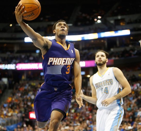 Feb 18, 2014; Denver, CO, USA; Phoenix Suns guard Ish Smith (3) shoots the ball during the second half against the Denver Nuggets at Pepsi Center.  The Suns won 112-107 in overtime.  Mandatory Credit: Chris Humphreys-USA TODAY Sports