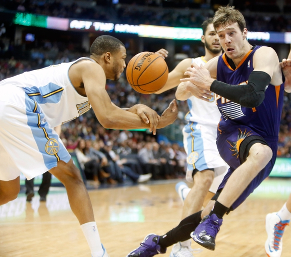 Feb 18, 2014; Denver, CO, USA; Phoenix Suns guard Goran Dragic (right) is stripped of the ball by Denver Nuggets guard Jordan Hamilton (left) during the second half at Pepsi Center.  The Suns won 112-107 in overtime.  Mandatory Credit: Chris Humphreys-USA TODAY Sports
